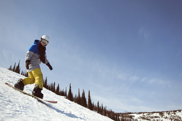 Snowboard female on snow mountain. Winter sport holiday mountains sky resort