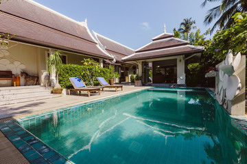 Private swimming pool near luxury villa. Sunny summer travel vacation