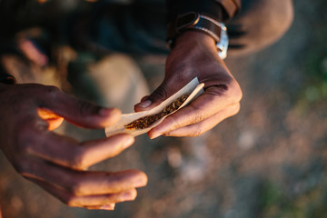 Hands holding hashish and tobacco. Hash which is a drug made from herbal cannabis marijuana