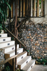 Staircase  steps and old stile wooden door in tropical  luxury villa