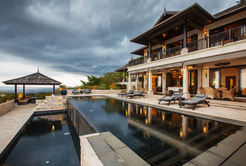 Luxury tropical villa with big swimming pool interior outside
