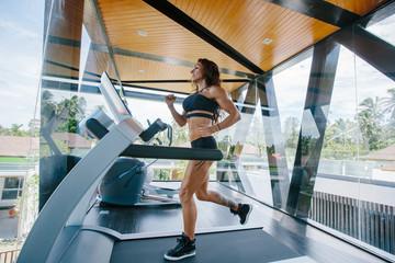 Athlete  female running in gym