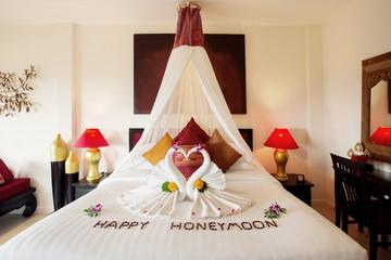 Luxury hotel bedroom interior with honeymoon decoration