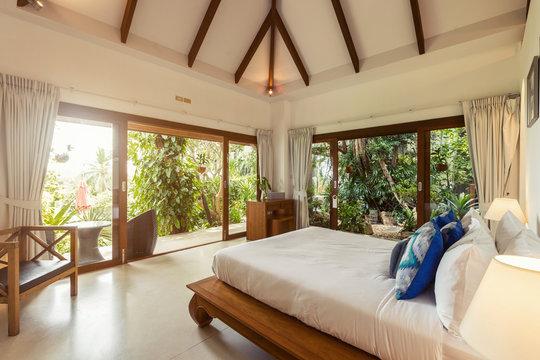 Modern bed room interior in Luxury villa. White colours, big window