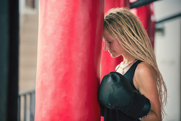 Woman with dread locks and boxing gloves
