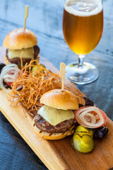 white cheddar beef sliders, shoestring potatoes and a beer