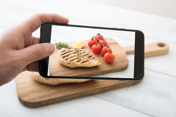 photographing chicken breast with smart phone
