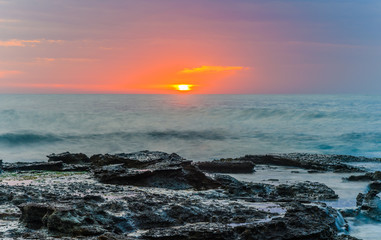 Sunrise Seascape and Rocky Headland
