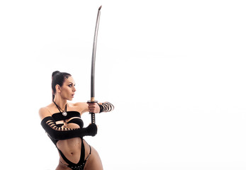 Erotic ninja. Perfect female body with a katana sword. Cosplay.