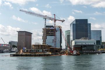 waterfront view skyline Boston MA, USA new skyscraper construction near waterfront bay