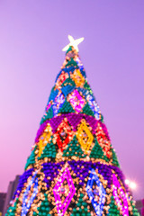 Night illumination of Christmas and New Year celebration in colorful pastel theme.