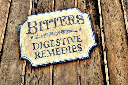 Vintage style sign on a wooden background.