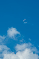 moon rise above the cloud under the blue sky background