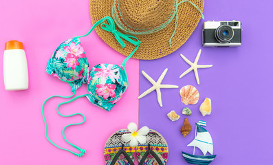 Summer Fashion woman swimsuit Bikini, camera, fish star, sunblock, sun glasses, hat. Travel in the holiday purple and pink color background.  Summer Concept.