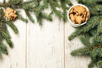 NewYear. Delicious ginger biscuits. Fir branch. Light background