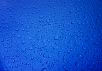Rain drops on blue