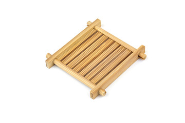 asian style old square bamboo coasters on white background.