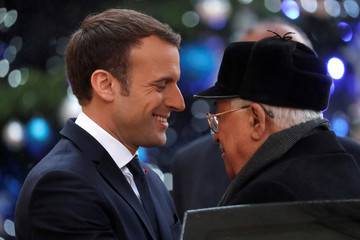 French President Emmanuel Macron welcomes Palestinian President Mahmoud Abbas at the Elysee Palace in Paris
