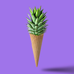 Ice cream cone with pineapple leaves on bright purple background. Fruit and candy concept.
