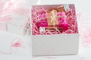 Essential oils and handmade soap in gift box