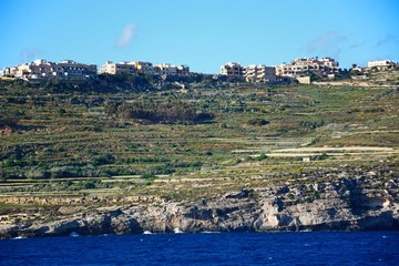 View of the Gozo coastline seen from the ferry, Malta.