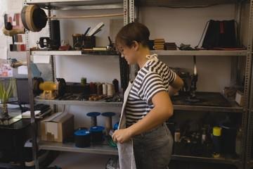Female worker wearing apron in workshop