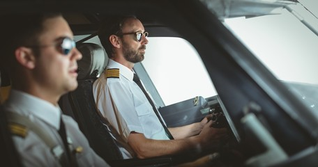Pilot and copilot flying an airplane