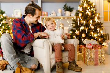 New Year's photo of son and father in armchair