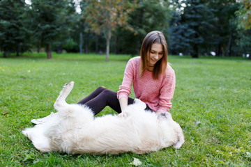 Photo of brunette and retriever lying on lawn