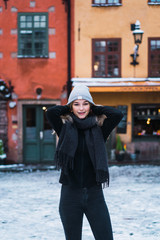 Pretty woman on street in winter