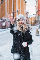 Woman throwing up snow