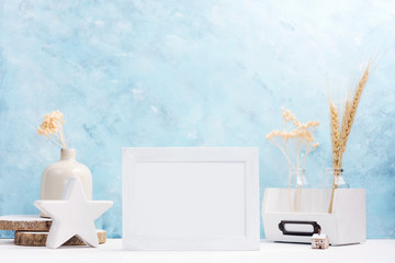 White horizontal Photo frame mock up with plants in vase, ceramic decor on shelf. Scandinavian style. Text space