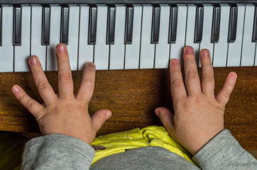 Little child learn to play the piano