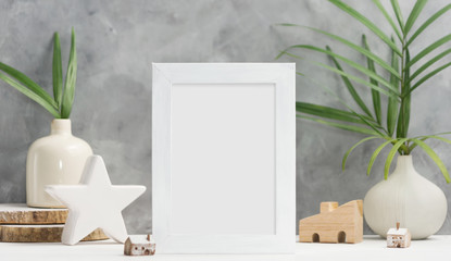 Photo frame mock up with plants in vase, ceramic decor on shelf. Scandinavian style. Text space