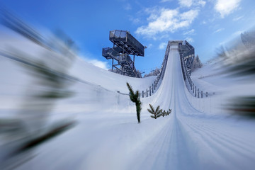 View from the take-off zone to the point of departure. Ski jumping hill Seefeld, Austria.