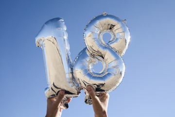 number-shaped balloons forming the number 18