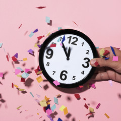 clock at five to twelve and confetti