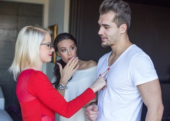 Blonde woman flirting with disloyal man, girlfriend in shock
