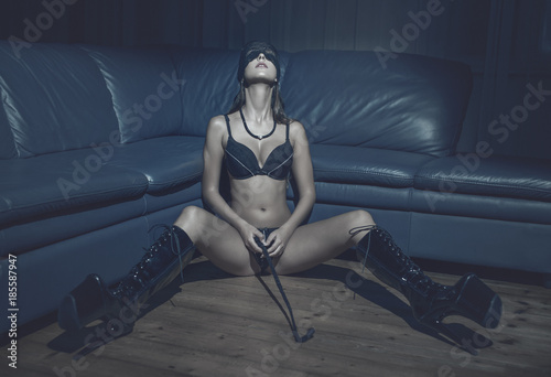 Sexy Passionate Woman In Blindfold And Latex Boots Holding Whip On Floor