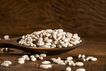 White beans on wood background