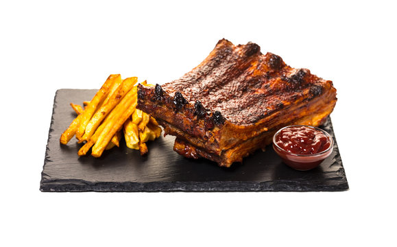 grilled ribs with fries and sauce