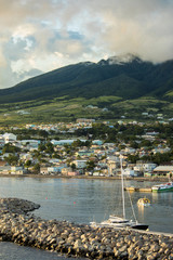 Basseterre, St Kitts with Mt Liamuiga volcano in the background at sunset.