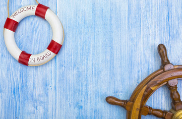 Maritime background with helm and lifebuoy
