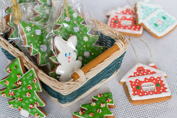 New Year's gingerbread decorated with icing in a basket. Christmas homemade gingerbread cookie in a wicker basket. Christmas and new year card with free text space.