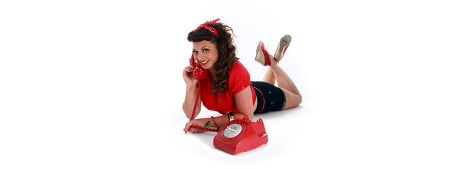 red telephone woman on a vintage phone