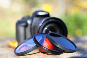 Three photo filters with a camera