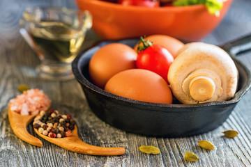 Vegetables, eggs and mushrooms. Rustic food