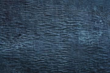 Dark blue stone background with wavy lines