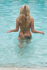 Beautiful women in a swimsuit, or mermaids tail above and below the water.