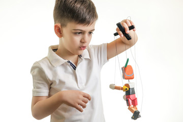 Studio shot of young boy playing with wooden retro Pinocchio toy